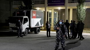 A truck carrying the first batch of doses of the Pfizer/BioNTech vaccine against the coronavirus disease (COVID-19) arrives at Rafik Hariri University Hospital, in Beirut, Lebanon February 13, 2021.