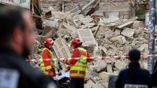 Rescuers worked through the night looking for victims in the rubble of the two buildings