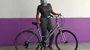 Mexican doctor Daniela Chavez shows off the bicycle she received from the Biciteka foundation in Mexico City