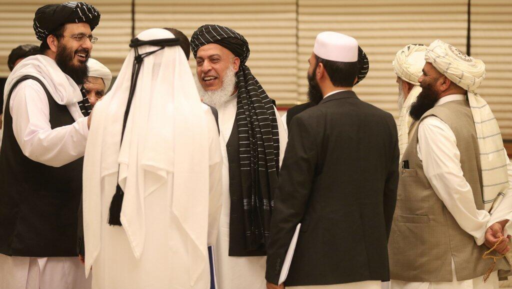 Miembros de la delegación afgana en el segundo día de la reunión entre los talibanes y funcionarios afganos, el 8 de julio de 2019, en Doha, Qatar.