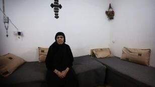 """العراقية ظريفة باكوس دادو من المسيحيين الذين لم يتمكنوا من مغادرة قراهم وبلداتهم بعد سيطرة تنظيم """"الدولة الإسلامية"""" عليها"""