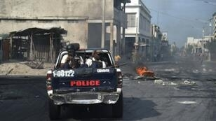 Haitian Police patrol the streets of Port-au-Prince, on November 21, 2018, during the third day of strikes