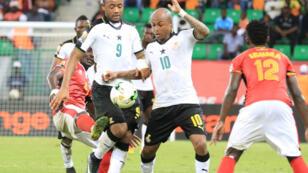 Les frères Ayew en action pour le premier match des Black Stars qui l'ont emporté sur l'Ouganda 1-0.