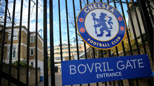 The logo of Chelsea Football Club is pictured on a closed gate at Stamford Bridge football stadium in London on March 13, 2020.