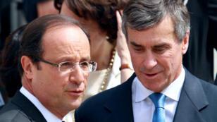 Le président François Hollande, aux côtés de Jérôme Cahuzac alors ministre du Budget, en juillet 2012.