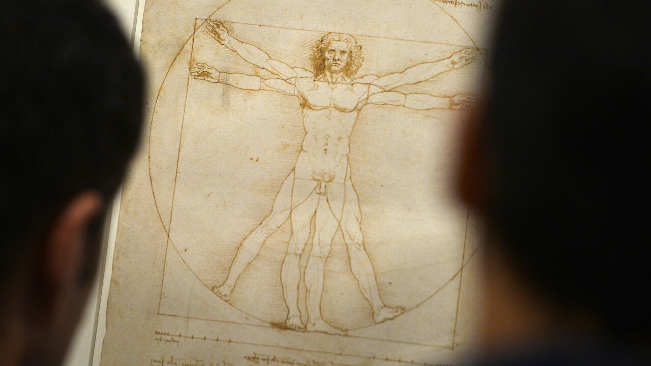 "People look at the ""Vitruvian Man"" a drawing by Leonardo da Vinci, in August 2013 in Venice."