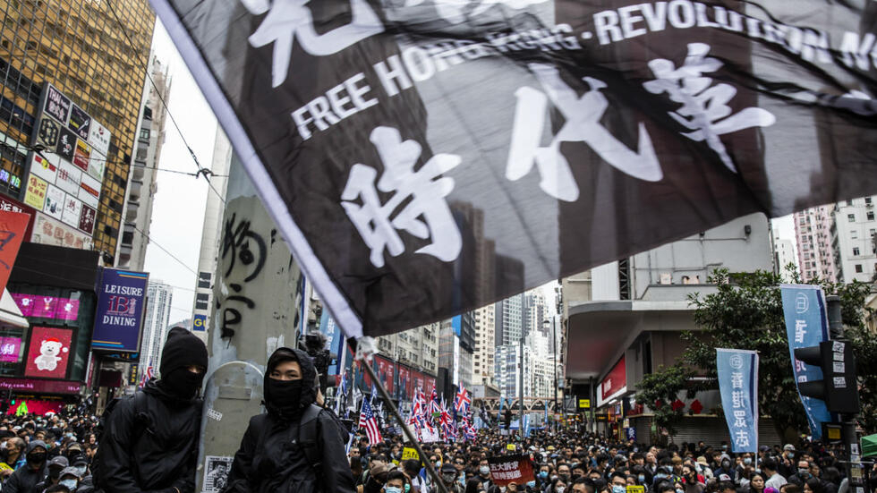 Anti-government protesters attend a demonstration to call for better governance and democratic reforms in Hong Kong on January 1, 2020.