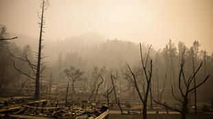 The remains of the guest houses at Calistoga Ranch smoulder after the Glass Fire passed through