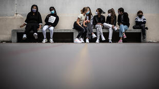 Students wearing masks in the courtyard of a school in Vincennes, east of Paris, on September 1, 2020, the first day of the school year.