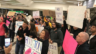 Dan Derozier @danderozier | People protest at Houston George Bush Intercontinental Airport on January 28, 2017.