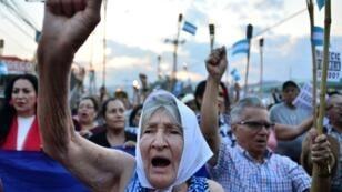 Protestors march to demand the resignation of Honduran President Juan Orlando Hernandez