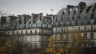 The suitcase filled with cash was found in a locked cellar in an upscale suburb of Paris.