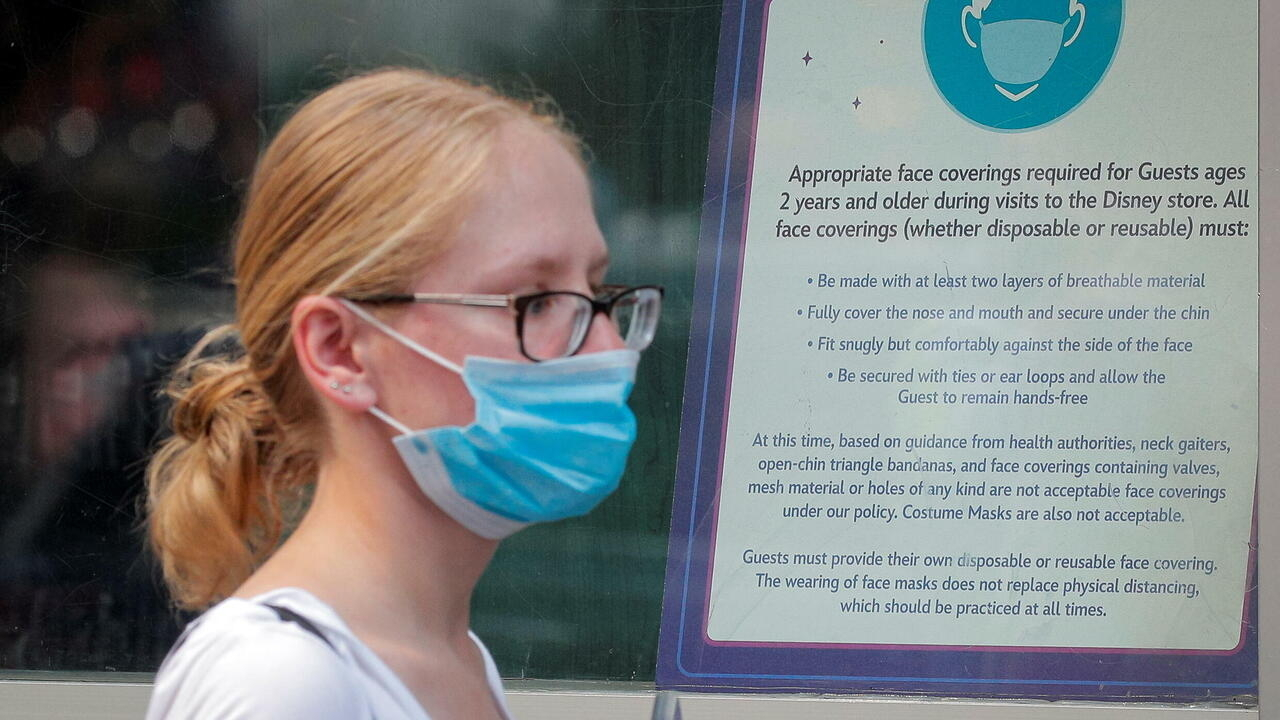 US reverses mask policy saying vaccinated people should wear them indoors