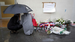 File photo of mourners at a memorial to the victims of the January 7, 2015, attacks, outside the former Charlie Hebdo offices in Paris.