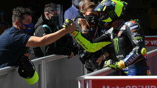 Valentino Rossi (R) will start the Catalonia MotoGP in the front row after signing a one-year contract extension with Yamaha