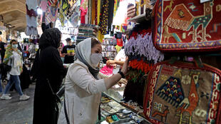 Iranians shop at the Grand Bazaar in the capital Tehran