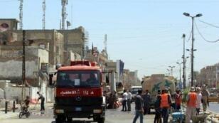 موقع انفجار سيارة مفخخة استهدف سوقا في بغداد، الإثنين 30 ايار/مايو 2016