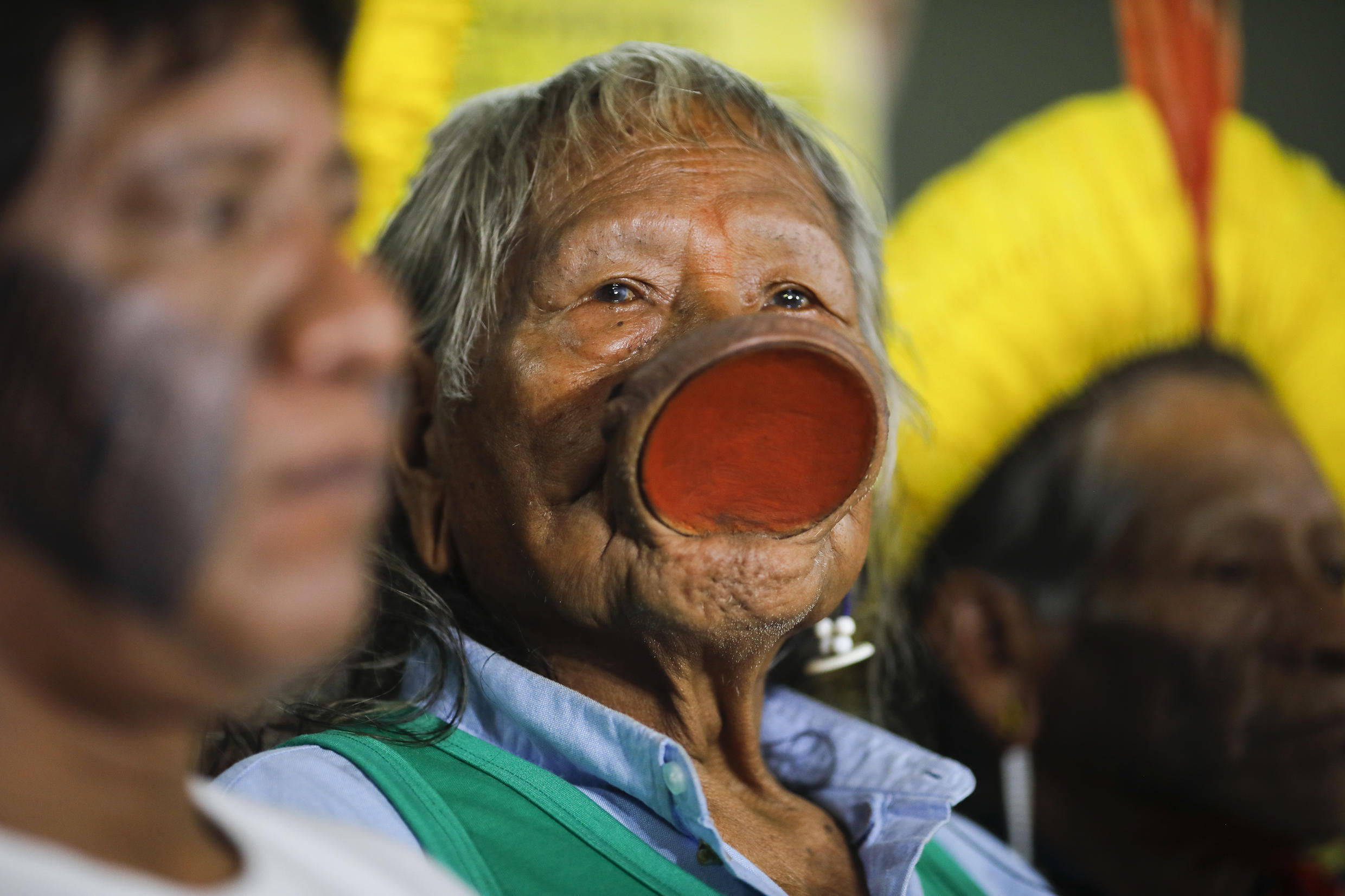 Brazil's indigenous chief Raoni Metuktire (C) speaks with journalists at the chamber of deputies, in Brasilia, on February 18, 2020.