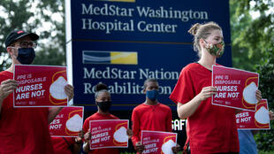 Nurses and their supporters protest demanding better Personal Protective Equipment outside MedStar's Washington Hospital Center on July 23, 2020, in Washington, DC