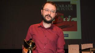 """Riad Sattouf lors de la remise de son """"Fauve d'or"""" au festival d'Angoulême, le 1er février 2015."""