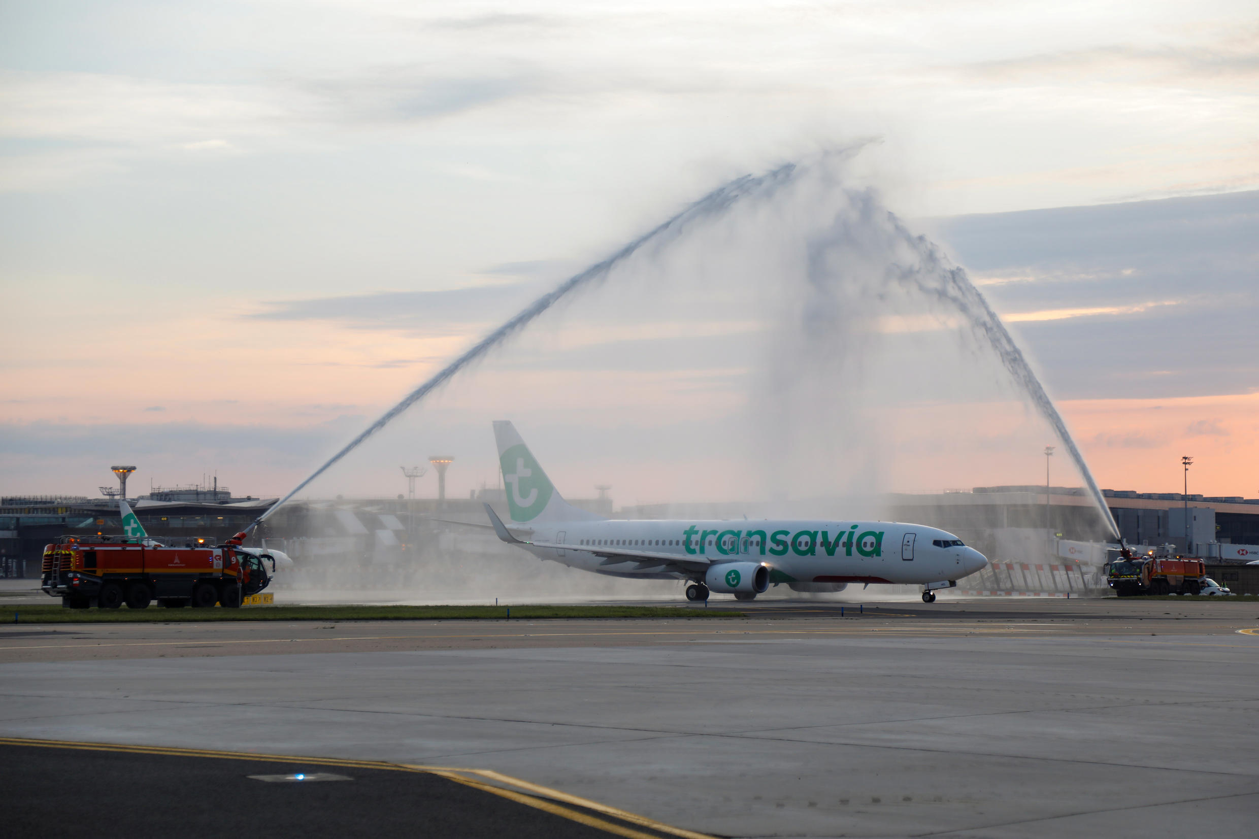 """A Transavia flight bound for Porto, Portugal gets a """"water salute"""" at Orly airport, Paris on June 26, 2020."""