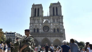 A French soldier patrols next to the Notre-Dame cathedral in Paris on December 24, 2015 as part of security measures set following the November 13 Paris terror attacks.
