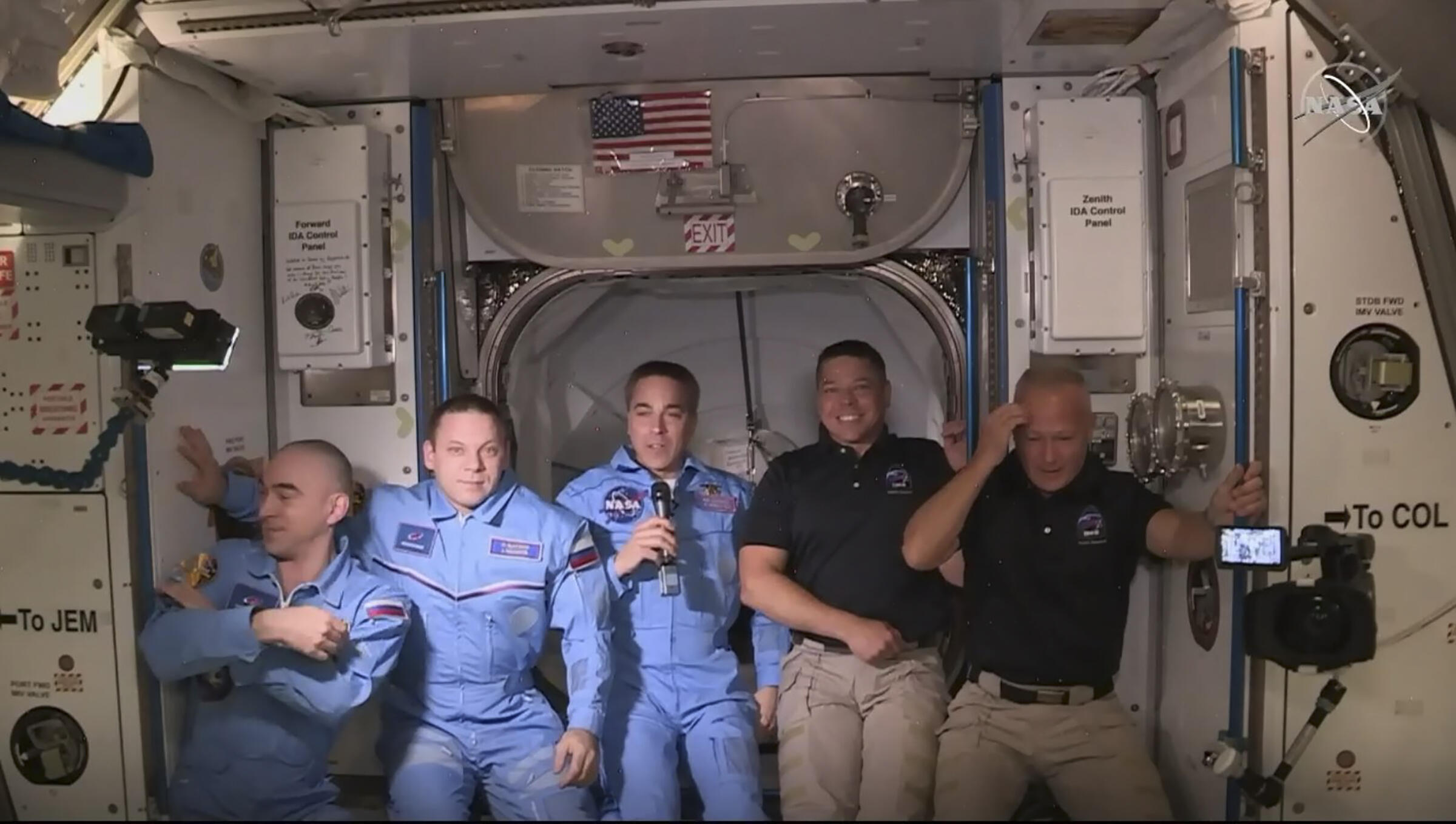 NASA photo shows astronauts Douglas Hurley (right) and Robert Behnken (second right) at the International Space Station posing with other astronauts on May 31, 2020.