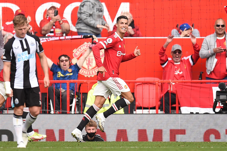 La joie de l'attaquant portugais de Manchester United, Cristiano Ronaldo, après avoir ouvert le score contre Newcastle, lors de leur match de Premier League, le 11 septembre 2021 au Stade d'Old Trafford