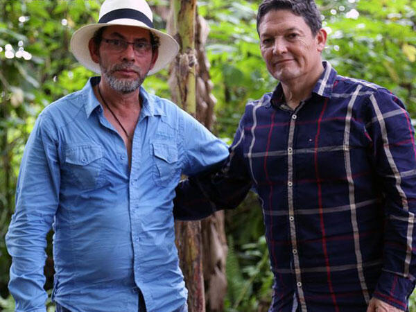 FARC propaganda photo shows guerilla commander 'Pastor Alape' (left) posing with captured general Ruben Alzate. 'Pastor Alape' flew to Colombia from Cuba to take part in Alzate's release. The general, who resigned, said he was forced into a 'media show'.