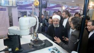 Le président iranien Hassan Rohani lors de la Journée mondiale de la technologie nucléaire, à Téhéran, le 9 avril 2018. Présidence iranienne, AFP