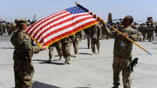 Des soldats américains lors d'une cérémonie dans une base militaire près de l'aéroport de Hérat, en Afghanistan, le 23 août 2014.
