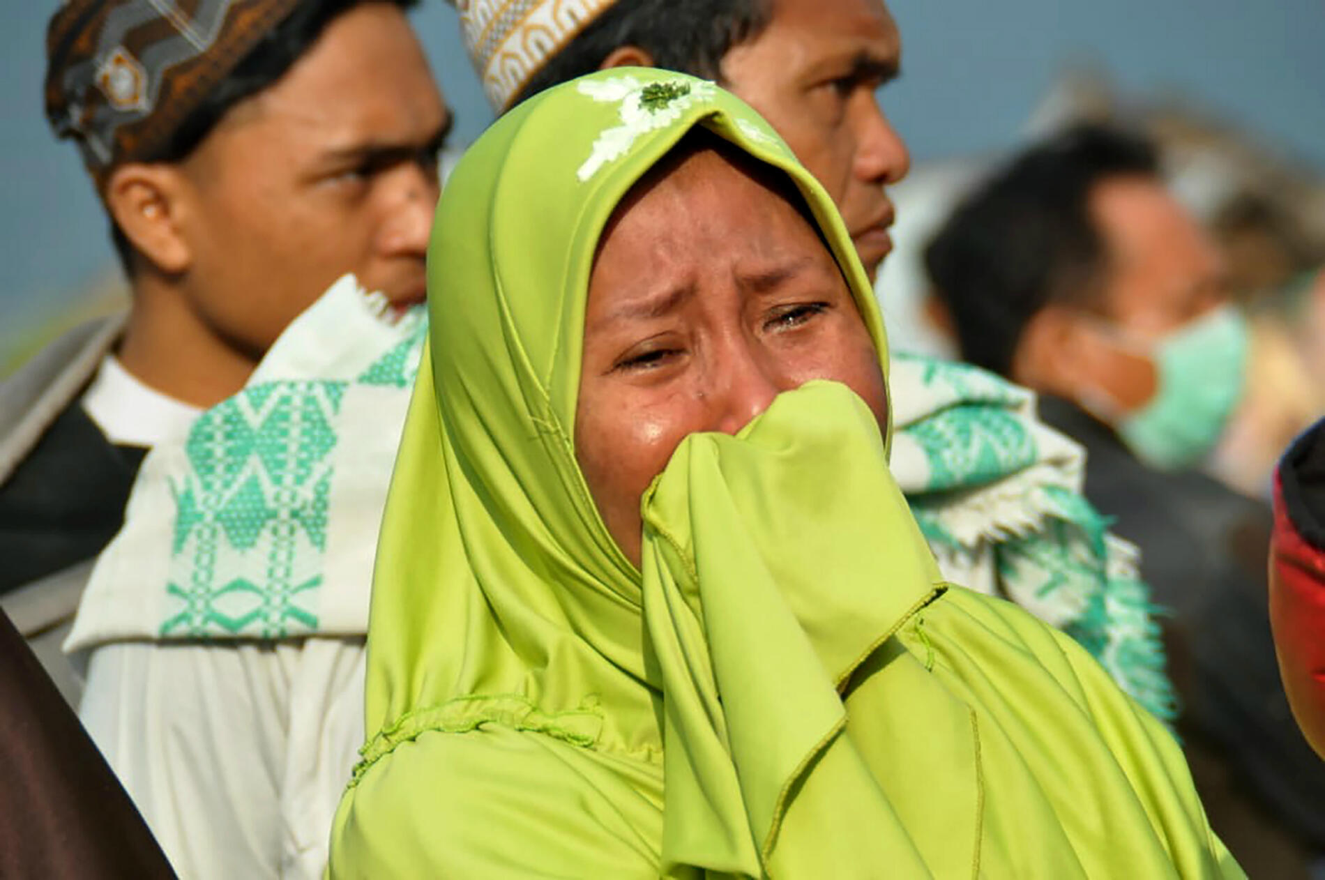 Muhammad Rifki, AFP | As survivors desperately search for their loved ones, many have received devastating news.