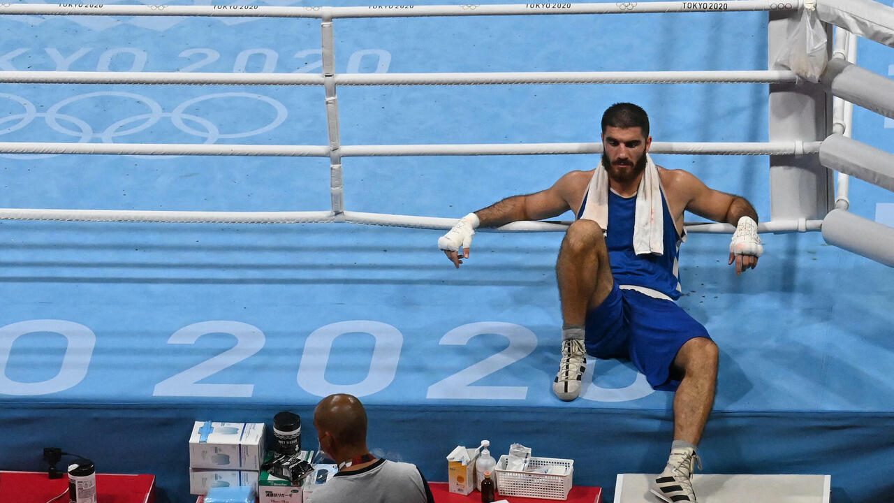 French boxer sits in protest after being disqualified from Olympics over head butt