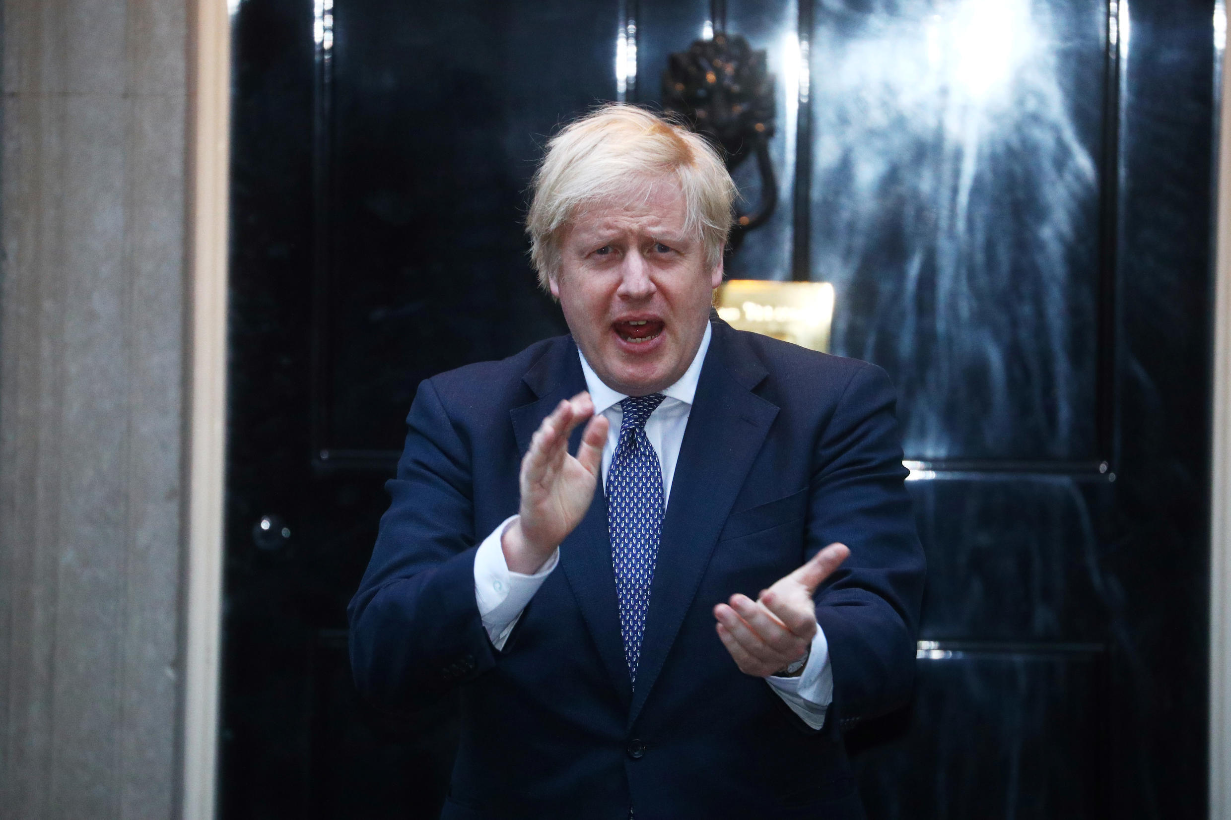 Britain's Prime Minister Boris Johnson applauds outside 10 Downing Street during the Clap for our Carers campaign in support of the NHS, following the outbreak of the coronavirus disease (COVID-19), in London, Britain, April 30, 2020.