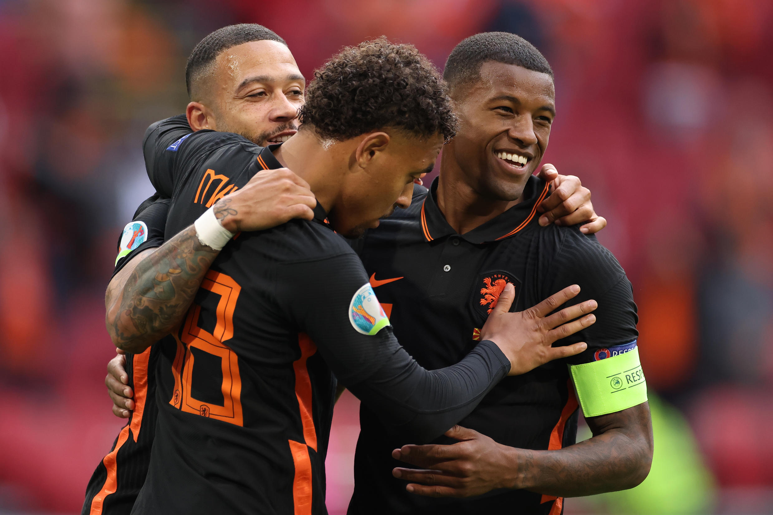 Georginio Wijnaldum (R) celebrates with Memphis Depay and Donyell Malen after scoring his second goal and the Netherlands' third against North Macedonia