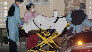 Medics transport a patient into an ambulance at the Life Care Center of Kirkland, the long-term care facility linked to several confirmed coronavirus cases in the state, in Kirkland, Washington, U.S. on March 6, 2020.