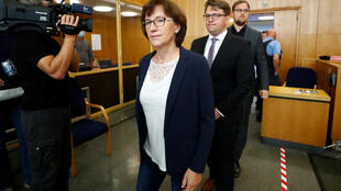Walter Luebcke's widow Irmgard Braun-Luebcke (L) and her sons Jan-Hendrick and Christoph Luebcke arrive for the trial of Stephan Ernst (not in picture), who is accused of murdering politician Walter Luebcke, at the Oberlandesgericht Frankfurt courthouse in Frankfurt am Main, Germany on August 5, 2020.