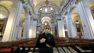 Sacristan Stephane, wearing a face mask, poses inside the Sainte Reparate Cathedral in Nice during the outbreak of the coronavirus disease in France, on April 30, 2020.