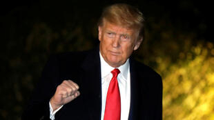 U.S. President Donald Trump gestures to the media on the South Lawn of the White House in Washington, U.S., before his departure to Davos, January 20, 2020.