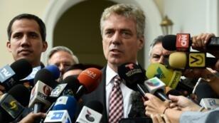 Germany's ambassador to Venezuela, Daniel Kriener, is seen here speaking to the press in February 2019 alongside opposition leader Juan Guaido (left)