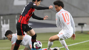 Frankfurt's Japan midfielder Daichi Kamada (L) scored the opening goal against Bayern Munich on Saturday