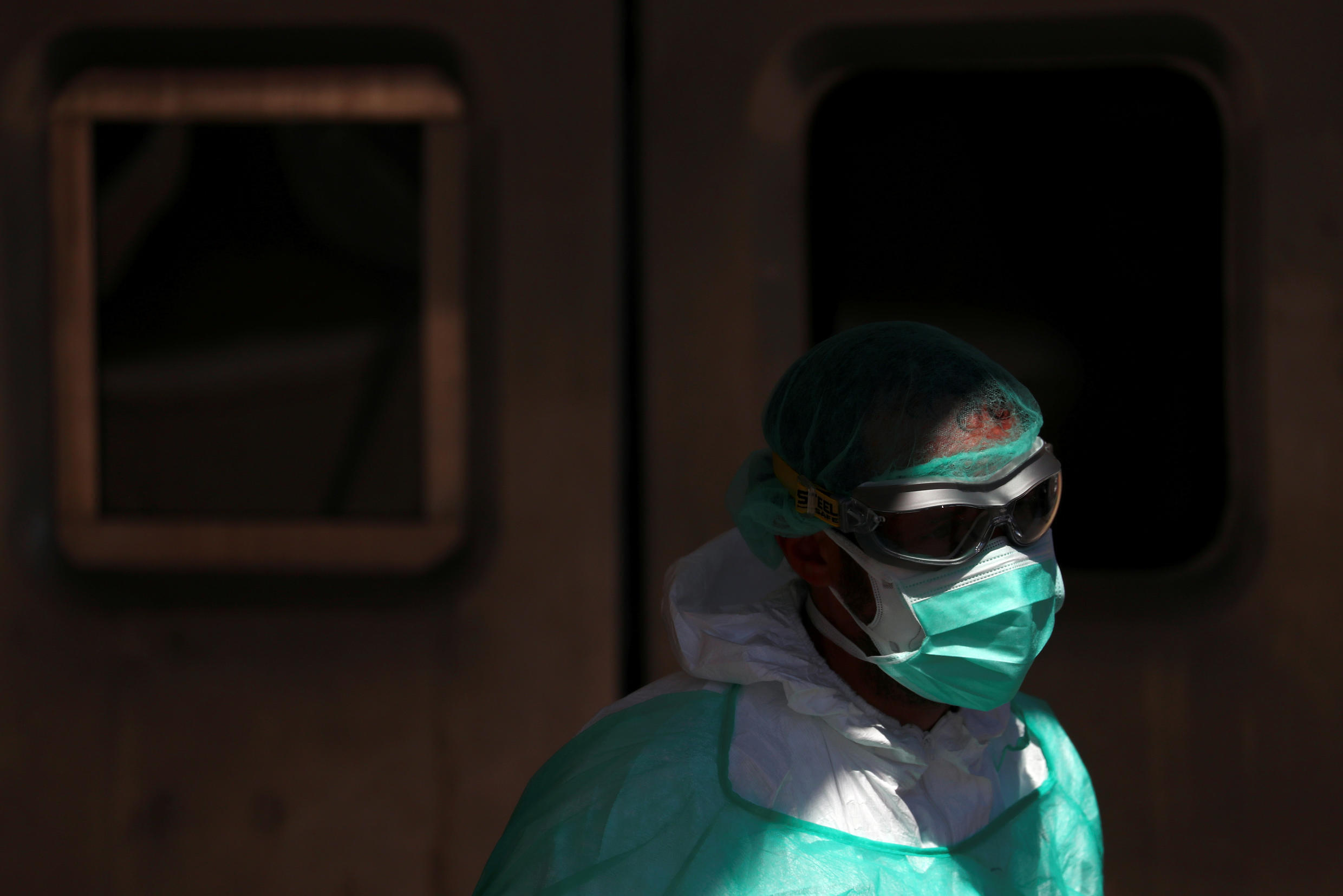 A healthcare worker near the entrance of the emergency unit in Madrid, Spain, March 28, 2020.