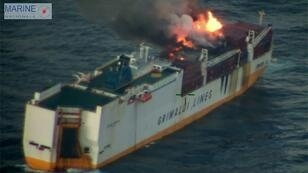 "A first tugboat to reach the stranded ""Grande America"" was unable to extinguish the flames, and two more were on their way Tuesday when the ship sank"