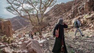 Umm Yasser guides a group of hikers through the rugged terrain of South Sinai, where tourism has been hard hit by Egypt's political turmoil