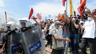 Police forces and anti-government protesters at Gezi Park in Istanbul, Turkey, on June 11, 2013.