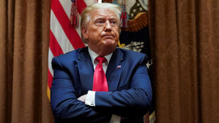 US President Donald Trump listens during a meeting with conservative black supporters in the White House in Washington, D.C., USA, June 10, 2020.