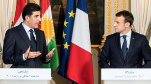 French President Emmanuel Macron (R) listens as Regional Kurdistan Government Prime Minister Nechirvan Barzani addresses a joint press conference at the Elysee Palace following a meeting in Paris on December 2, 2017.