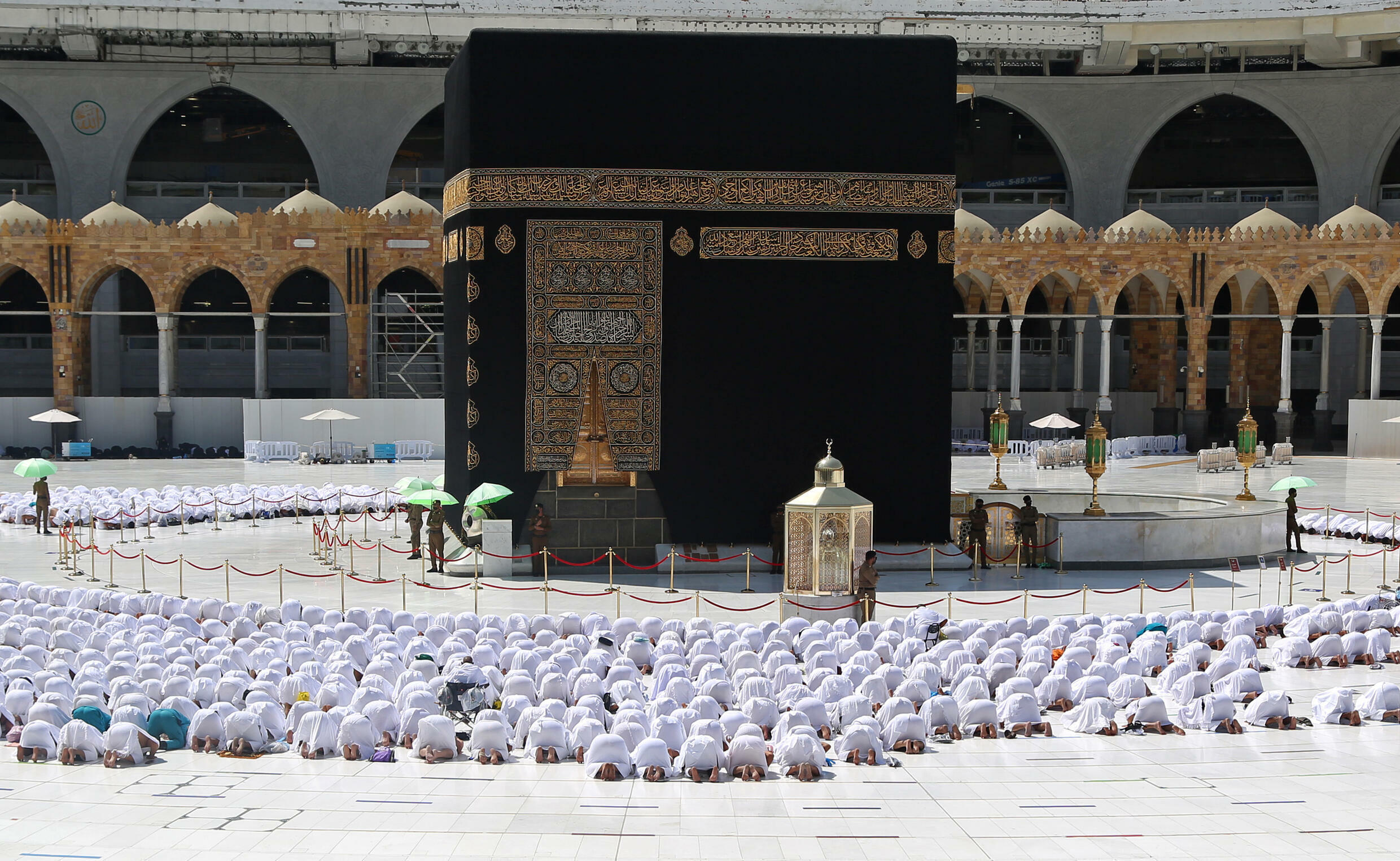 Normal service resumes: worshippers pray shoulder to shoulder at the Grand Mosque in the holy Saudi city of Mecca on Sunday, after social distancing rules were eased