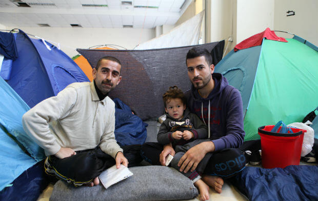 Hassan Haji (left) and Mallala al-Khany, two Yazidis from the Mosul region of northern Iraq, have been living at the camp at Ellinikon Airport since the end of February.