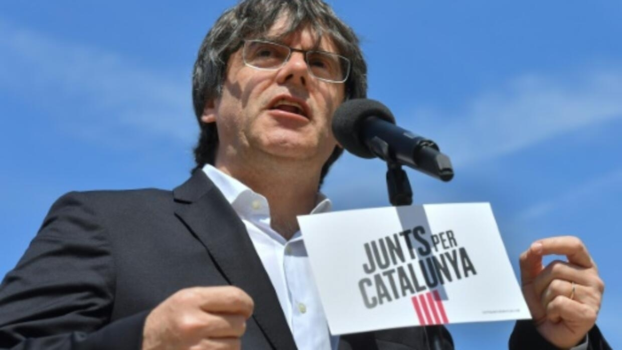 Spain hands Catalan separatists lengthy prison terms, issues warrant for ex-leader Puigdemont